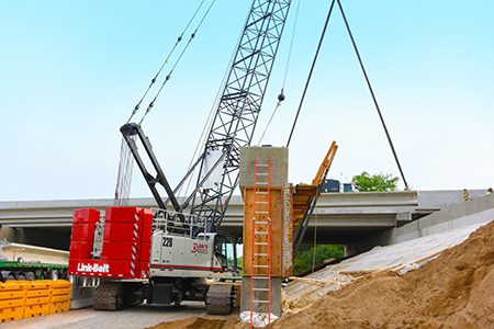 Dan's Excavating Improving Michigan Roads with New 228 HSL | Link